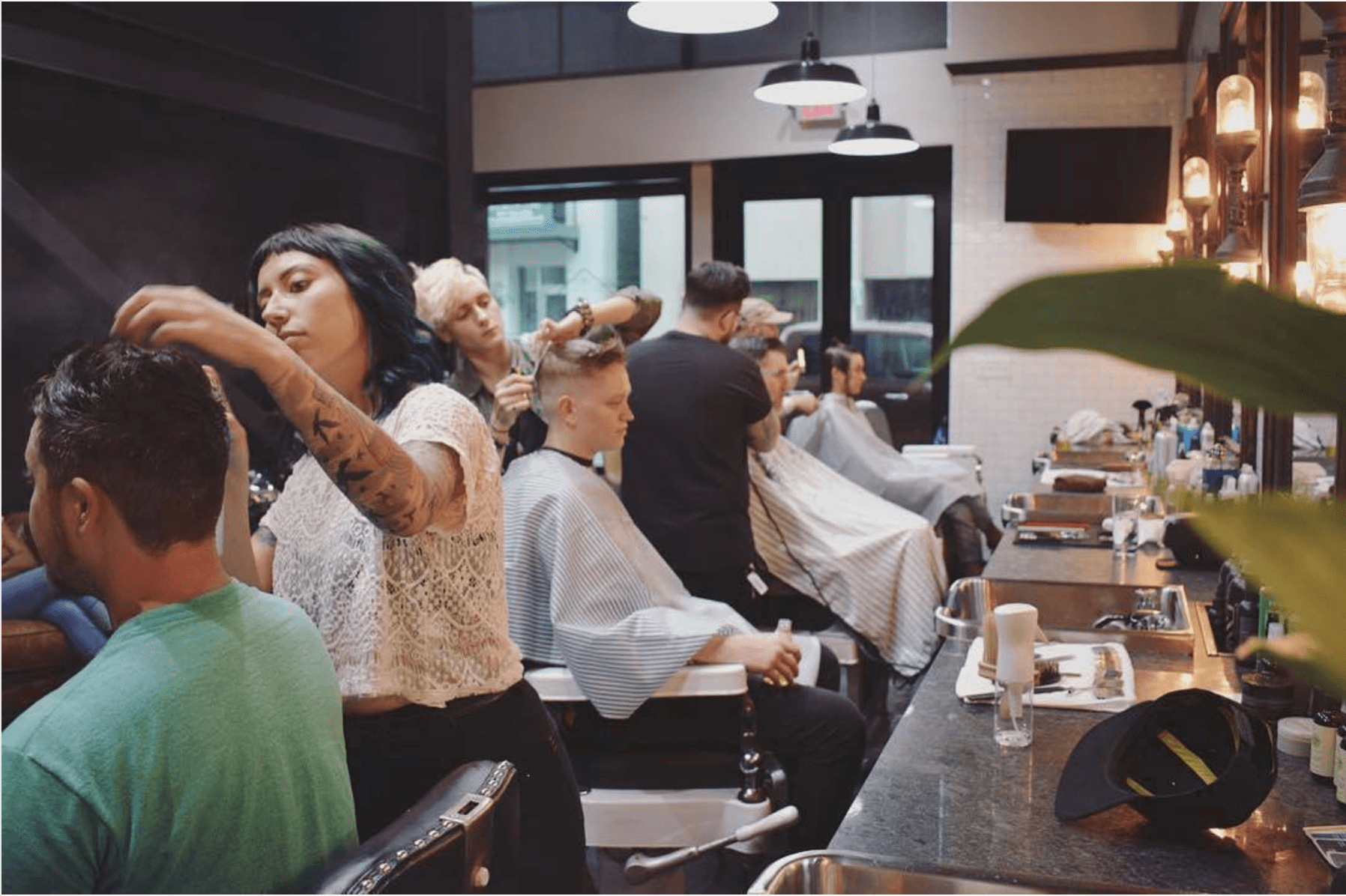Picture of stylists doing clients hair